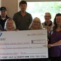 Lakepoint Golf & Country Club presents cheque to North Peace Mental Health Society